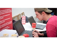 Student accessing the SU website on a laptop