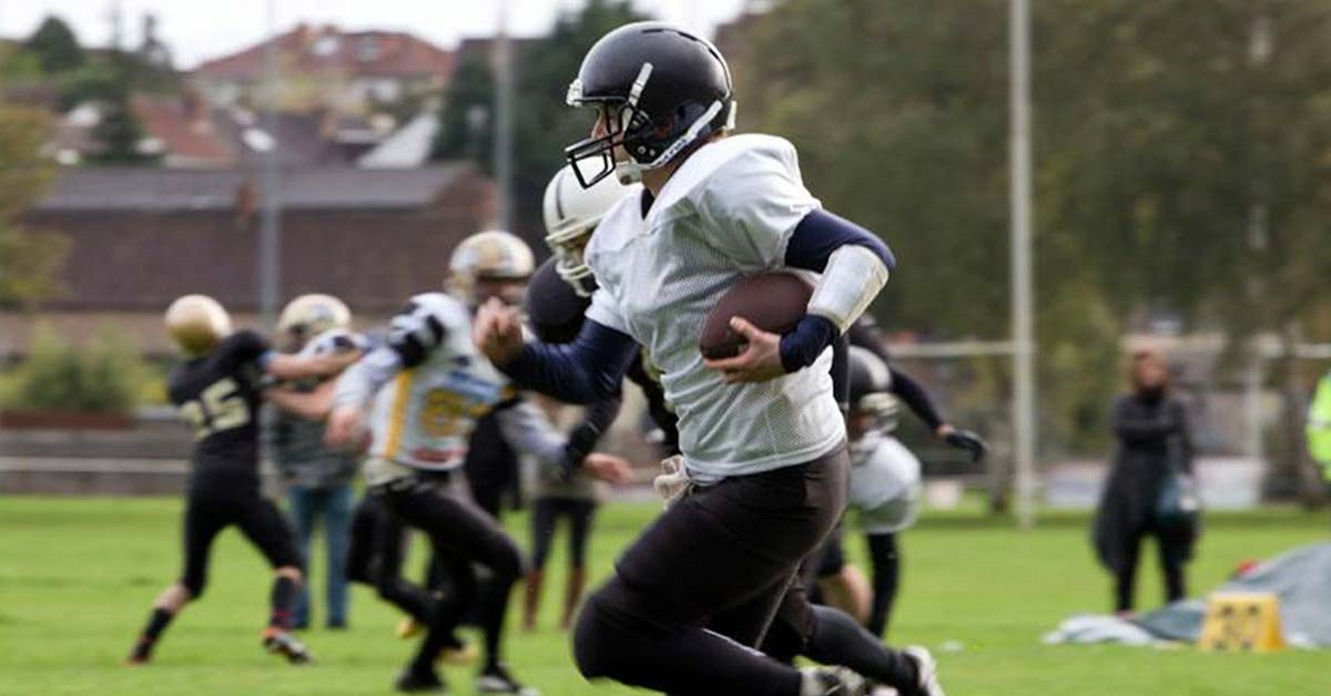A person playing American Football