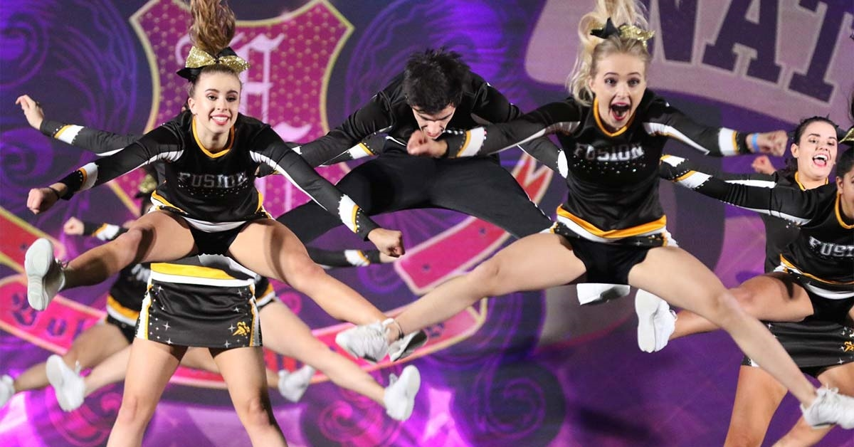 Cheerleaders doing a pike jump in a routine