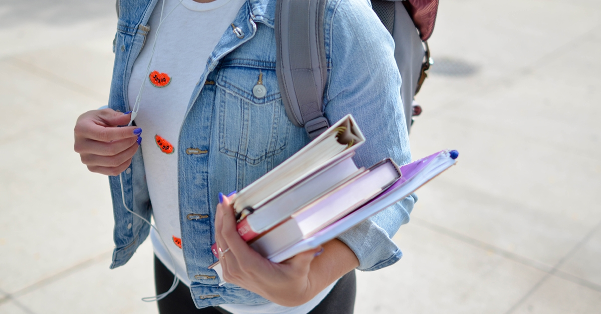 Student carrying books and notes