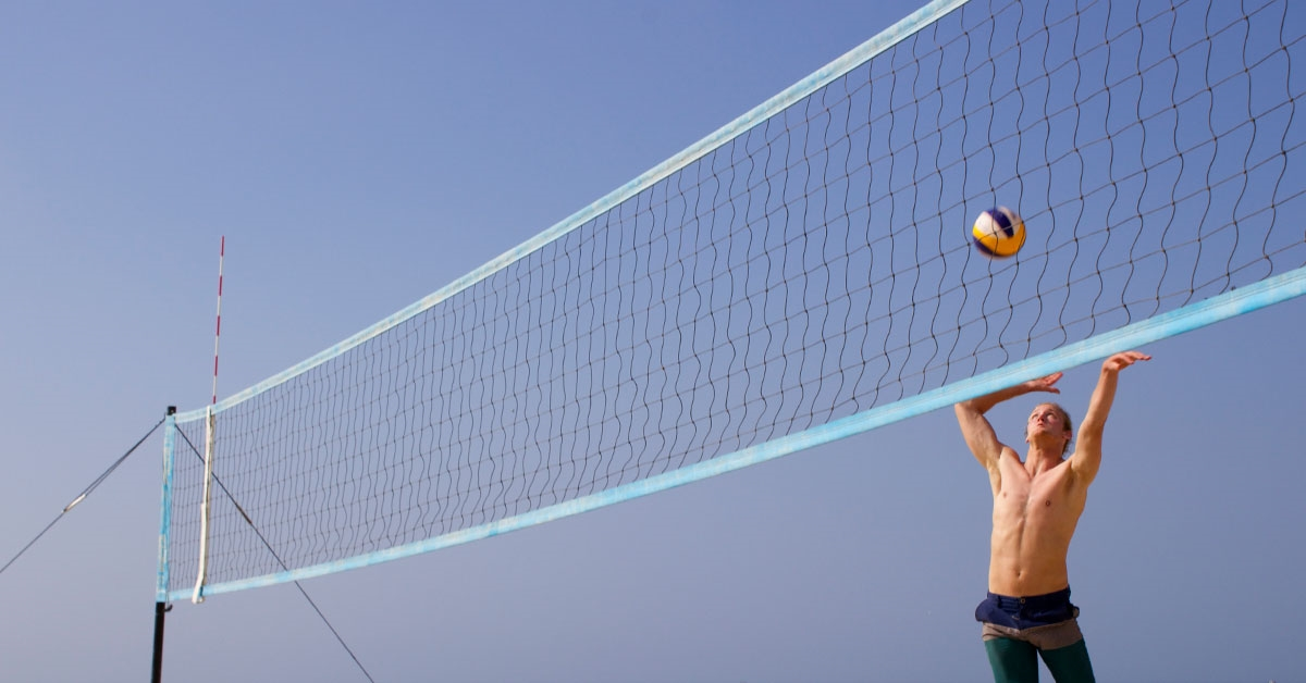 A student playing volleyball.