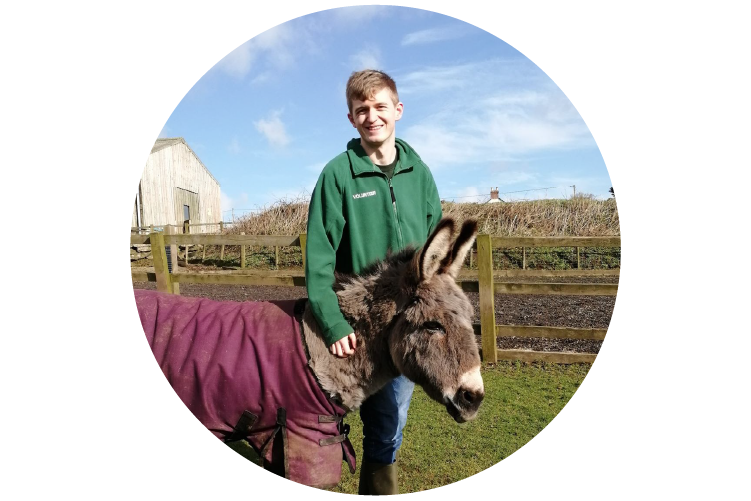 Photo of Matthew Slack and a donkey